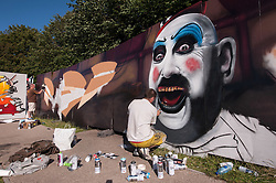 © Licensed to London News Pictures. 25/07/2015. Bristol, UK.  Giant mural works on the sides of buildings at Upfest 2015, Europe's largest, free, street art & graffiti festival, attracting over 250 artists painting 28 venues throughout Bedminster & Southville, Bristol.  Talented artists travel from 25 countries and across the UK to paint live on 30,000sqft of surfaces in front of 25,000 visitors. There is also an affordable art sale, music stages and art workshops.  Photo credit : Simon Chapman/LNP