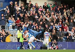 QPR's Matt Smith (left) celebrates scoring his side's second goal of the game during the Sky Bet Championship match at Loftus Road, London.