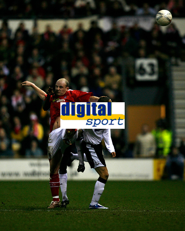 Ryan Smith of derby County (white, right) tries to control the ball