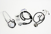 Three stethoscopes on white background
