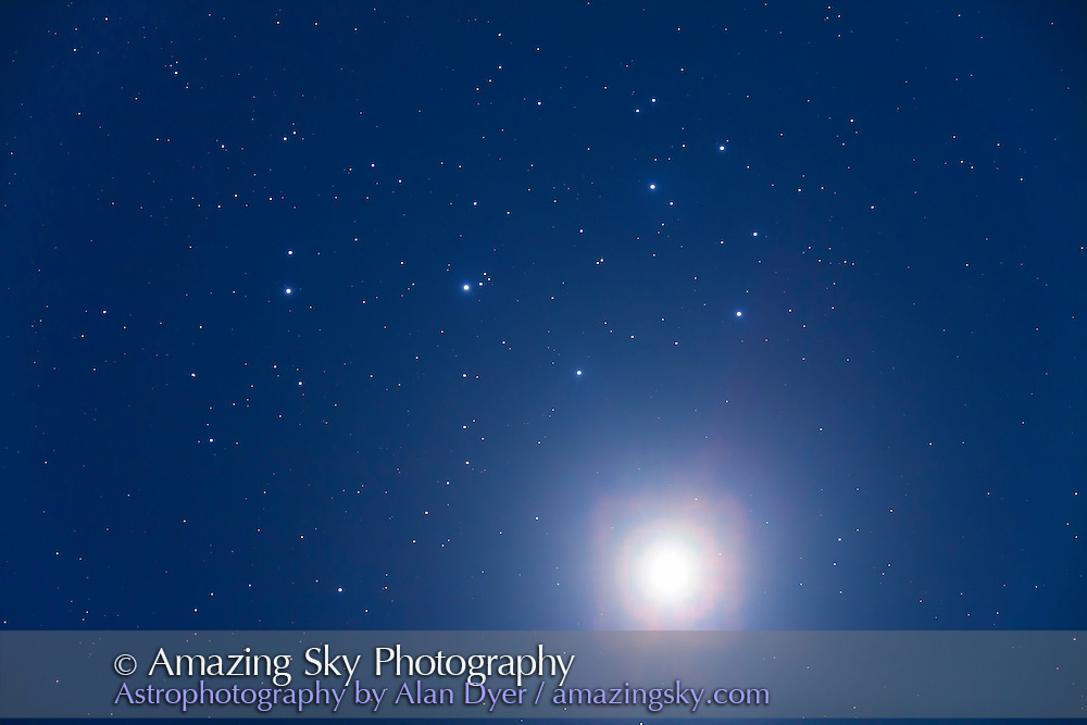 Venus below the Pleiades, M45, on April 2, 2012, the night before closest approach to the cluster. This is a single long exposure for 30 seconds at ISO 1000 with the Canon 5D MkII on the Astro-Physics 130mm f/6 with the field flattener. Internal reflection in the camera caused the odd reddish and squarish halo around Venus.