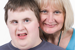 Portrait of a mother and teenage son with Downs Syndrome,