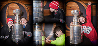 OTTAWA, ON - DECEMBER 15: Children pose with The Stanley Cup during the Stanley Cup Experience at Sens House as part of the Scotiabank NHL 100 Classic weekend featuring the Ottawa Senators and the Montreal Canadiens in Ottawa, ON. Canada on Dec. 15, 2017.<br /> <br /> PHOTO'S: Steve Kingsman / Freestyle Photography for the NHL