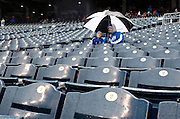 Kansas City Royals fans sit in the rain during a delay in the fourth inning of a baseball game against the Tampa Bay Rays at Kauffman Stadium in Kansas City, Mo., Thursday, May 2, 2013.  (AP Photo/Colin E. Braley).