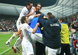 Slovenian players (Andraz Kirm (17), Robert Koren (8), Andrej Komac (3)) celebrate at the fourth round qualification game of 2010 FIFA WORLD CUP SOUTH AFRICA in Group 3 between Slovenia and Northern Ireland at Stadion Ljudski vrt, on October 11, 2008, in Maribor, Slovenia.  (Photo by Vid Ponikvar / Sportal Images)
