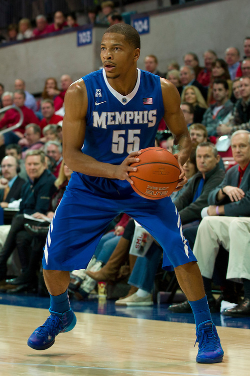 DALLAS, TX - FEBRUARY 01: Geron Johnson #55 of the Memphis Tigers brings the ball up court against the SMU Mustangs on February 1, 2014 at Moody Coliseum in Dallas, Texas.  (Photo by Cooper Neill/Getty Images) *** Local Caption *** Geron Johnson