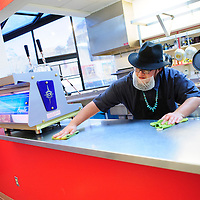 010713  Adron Gardner/Independent<br /> <br /> Pete Little Elk cleans down the order counter at Café Da'a'so before closing time at the Navajo Nation Museum in Window Rock Tuesday.