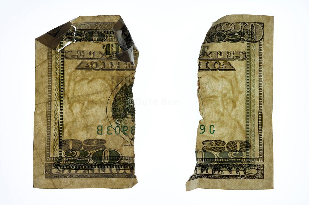 torn up 20 dollars bill