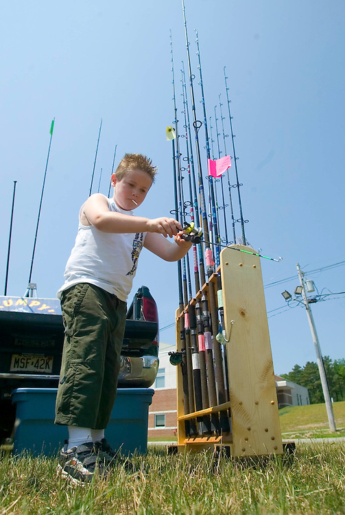 (PSUNDAY) Toms River 6/25/2005 6 year old Nathaniel Bungay of Lakehurst plays around with a small fishing poll while at the Barnegate Bay Festival held at the Ocean County College.  Michael J. Treola Staff Photographer.....MJT