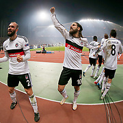 Besiktas's Serdar Kurtulus (L), Olcay Sahan (C) with team mates celebrate his goal during the UEFA Europa League Round of 32 second leg soccer match Besiktas between Liverpool at Ataturk Olimpiyat stadium in Istanbul Turkey on Thursday February 26, 2015. Photo by Aykut AKICI/TURKPIX