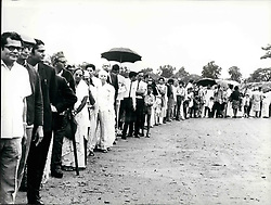1968 - What Happened To Uganda's Asian Citizens? When Uganda's President Idi Amin decreed that the non-citizen Asians must go, it was said that there were 8,000 citizens who, presumably would stay. When they were counted recently, only a few hundreds appeared. The exodus which followed the president's order to all non-citizen Asians to quit the country has resulted in the departure of at least 45,000 people - many of them to England, others to Canada, the United States and elsewhere. Who is left? After initially saying that Asians who were Ugandan citizens must leave as well, President Amin Changed his mind and said that they might, after all, remain. It was estimated at the time that there were at least 8,000 citizens who could take advantage of this clemency. Yet when Amin organised a head-count after the expiry of the dealine for the Asians departure, only a few hundred people appeared. What had happened to the rest? Photo Shows: Kampala's few remaining Asians after the exodus is over, queue to be counted. (Credit Image: © Keystone Pictures USA/ZUMAPRESS.com)
