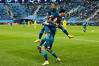 SAINT PETERSBURG, RUSSIA - DECEMBER 08: Malcom [top] and Aleksei Sutormin [bottom] celebrate after Sebastián Driussi [middle] opens the scoring for Zenit St. Petersburg during the UEFA Champions League Group F stage match between Zenit St. Petersburg and Borussia Dortmund at Gazprom Arena on December 8, 2020 in Saint Petersburg, Russia. (Photo by MB Media)