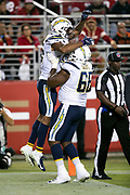 Los Angeles Chargers wide receiver Andre Patton (15) leaps and celebrates with Los Angeles Chargers rookie offensive tackle Trenton Scott (68) after Patton catches a 5 yard touchdown pass good for a 20-7 third quarter Chargers lead during the 2018 NFL preseason week 4 football game against the San Francisco 49ers on Thursday, Aug. 30, 2018 in Santa Clara, Calif. The Chargers won the game 23-21. (©Paul Anthony Spinelli)