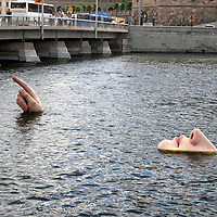 Europe, Sweden, Stockholm. Floating sculpture art in the river in front of the Modern Art Museum of Stockholm.