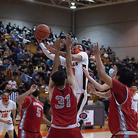 Gallup Bengal Joaquin Ortega (30) drives to the basket against the Bernalillo Spartans during their New Mexico Class 4A boys basketball quarterfinal game at Gallup High School in Gallup Tuesday. The Bengals defeated the Spartans 70-67.