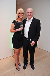 RICK STEIN and SARAH BURNS at an exhibition of photographic portraits by Bryan Adams entitled 'Hear The World' at The Saatchi Gallery, King's Road, London on 21st July 2009.