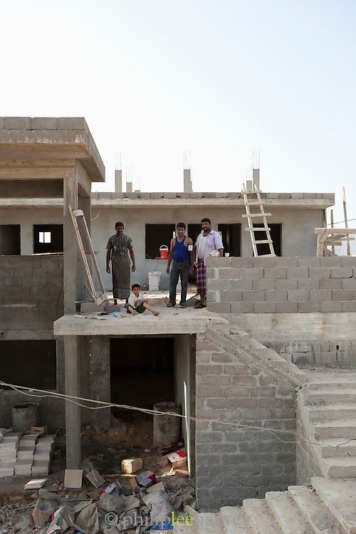 Socotras tourist industry is steadily increasing, including more construction of hotels. Construction workers building a hotel, Hadibu, Socotra, Yemen