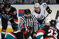 KELOWNA, BC - MARCH 26: Line official Jade Portman prepares to drop the puck during third period between Kelowna Rockets and the Victoria Royals at Prospera Place on March 26, 2021 in Kelowna, Canada. (Photo by Marissa Baecker/Shoot the Breeze)