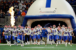 The Florida Gators run out agains the Michigan Wolverines during the Chick-fil-A Peach Bowl, Saturday, December 29, 2018, in Atlanta. ( Paul Abell via Abell Images for Chick-fil-A Peach Bowl)