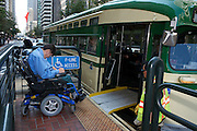 Bruce Oka waits to board the F Line Streetcar at Market and Beale Sts in San Francisco