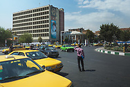 Savaris is a type of shared taxis popular in Tehran. They often have predefined routes and fares. It's common to share a savari between strangers to save money. Which means that sometimes it can take up to half an hour for a driver to fill up a car with passengers.