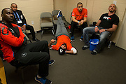 Johny Hendricks relax before his title fight against Robbie Lawler at UFC 171 by watching the undercard in his locker room at the American Airlines Center in Dallas, Texas on March 15, 2014.