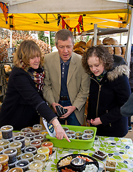 Pictured: Beth Berry, organiser of the Three Edinburgh Farmers markets, Willie Rennie and Hannah Bettsworth, Liberal Democrat candidate for Edinburgh Central and the Lothian regional list<br /> <br /> Liberal Democrat leader Willie Rennie and  Hannah Bettsworth, Liberal Democrat candidate for Edinburgh Central and the Lothian regional list, headed to Stockbridge today to meet Easter shoppers and stallholders at the Sunday farmers market. <br /> <br /> Ger Harley | EEm 27 March 2016