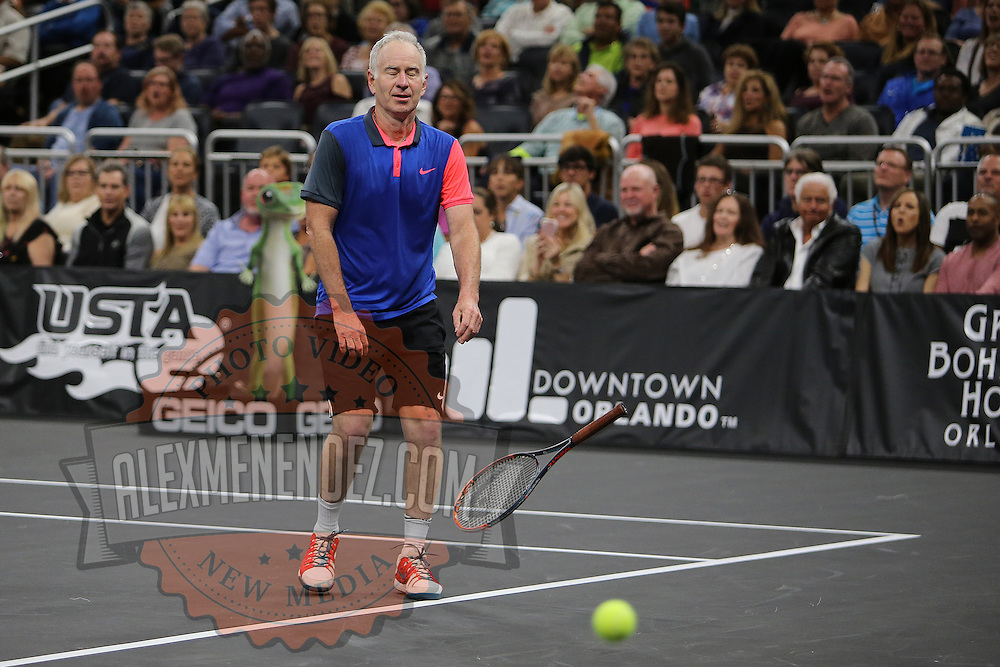 Tennis champion John McEnroe throws his racquet during the PowerShares Tennis Series event at the Amway Center on January 5, 2017 in Orlando, Florida. (Alex Menendez via AP)