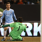Goalkeeper Luis Marín, Sporting KC, saves from Patrick Mullins, NYCFC, during the New York City FC Vs Sporting Kansas City, MSL regular season football match at Yankee Stadium, The Bronx, New York,  USA. 27th March 2015. Photo Tim Clayton