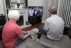 Gillian and James Byrne from Liverpool watch the the International Friendly between England and Switzerland as the first 25 seconds are shown in black and white.
