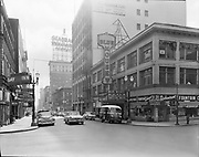 Simon 047. Eastern Outfitting Co. building & Blue Mouse Theatre from 11th & Washington. March 27, 1956 Gay Inn.