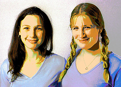 Portrait of two teenage girls smiling,