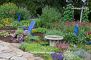 63821-21812 Flower garden with stone path, blue Adirondack chair, bird bath, butterfly house, bird house, and trellis, Purple Verbena, sedums, blue fescue grass, raspberry blast petunia and diamond frost euphorbia in blue pot, Butterfly Bushes, Joe Pye Weed (Eupatorium purpurea) Moon Vine on trellis, Raspberry Wine Bee Balm (Monarda didyma)  Marion Co., IL