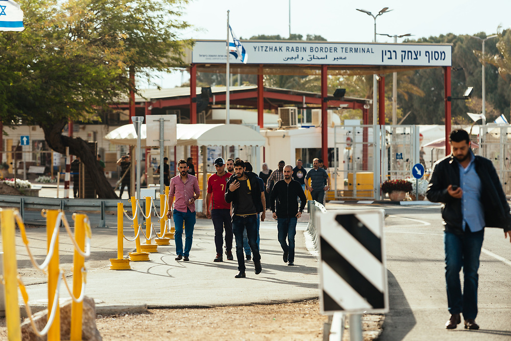 Jordanian workers make their way out of the Yitzhak Rabin Border Terminal in Eilat, southern Israel, on March 15, 2018,  after crossing the border from Jordan into Israel.