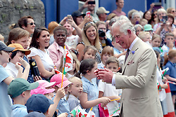 July 4, 2018 - Builth Wells, United Kingdom - Image licensed to i-Images Picture Agency. 04/07/2018. Builth Wells, Wales, United Kingdom. The Prince of Wales and the Duchess of Cornwall watch a pantomime performance during the reopening of the newly renovated Strand Hall in Builth Wells, Wales, United Kingdom. (Credit Image: © Pool/i-Images via ZUMA Press)
