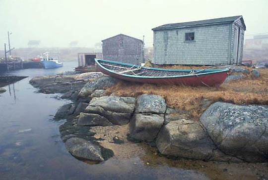 Foggy, morning at fishing village at Peggy's Cove. Nova Scotia. Canada. Fishing boats dry docked.