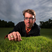 Charles Fontanier with grass that Oklahoma State University's Turf Management program developed in Stillwater, Oklahoma. OSU has studied and developed a variety grasses being used on sports fields and golf courses. Nathan Lambrecht/Journal Communications
