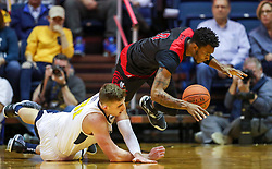 Dec 22, 2018; Morgantown, WV, USA; West Virginia Mountaineers forward Logan Routt (31) and Jacksonville State Gamecocks guard Jamall Gregory (0) drive for a loose ball during the first half at WVU Coliseum. Mandatory Credit: Ben Queen-USA TODAY Sports