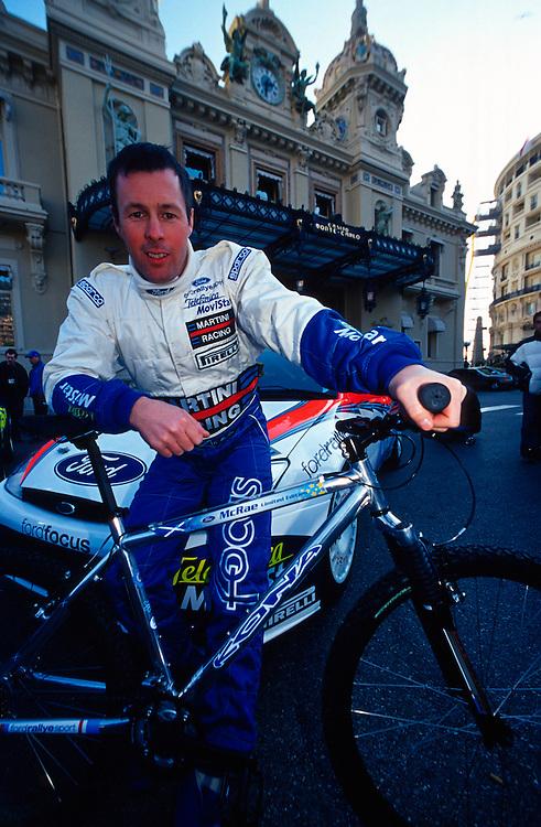 Late, great rally driver Colin Mcrae with his signature Kona mountain bike. Monte Carlo, Monaco.
