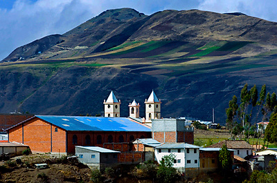 The Andes mountains provide a scenic background for the village of Ingapirca, Ecuador, the home of the Inca Temple of the Sun.