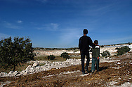Rushdi Toumeh walks with his son on the outskirts of the northern West Bank village of Qaffin...Photo by Erin Lubin