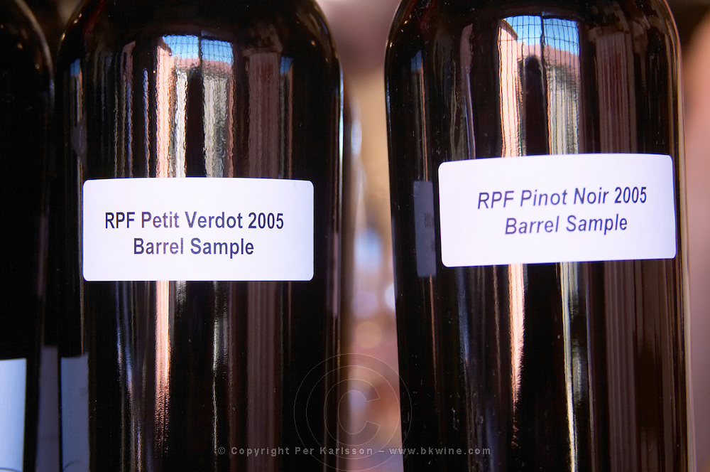 Bottles with barrel sample labels with RPF Reserva Personal de la Familia Petit Verdot 2005 and Pinot Noir Bodega Pisano Winery, Progreso, Uruguay, South America