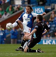 Photo. Glyn Thomas, Digitalsport.<br /> Blackburn Rovers v Leicester City. <br /> FA Barclaycard Premiership. 17/04/2004.<br /> Blackburn's Tugay (L) is challenged by Nikos Dabizas.