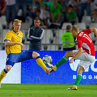 Sweden's Oscar Wendt (L) and Hungary's Vladimir Koman (R) fight for the ball during the UEFA EURO 2012 Group E qualifier Hungary playing against Sweden in Budapest, Hungary on September 02, 2011. ATTILA VOLGYI