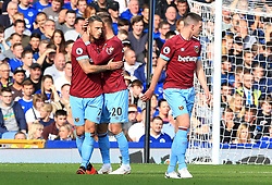 West Ham United's Andriy Yarmolenko (centre) celebrates scoring his side's first goal of the game with Marko Arnautovic (left) during the Premier League match at Goodison Park, Liverpool.