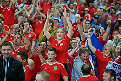 LILLE, FRANCE - Friday, July 1, 2016: Wales supporters celebrate the 3-1 victory against Belgium at full time after the UEFA Euro 2016 Championship Quarter-Final match at the Stade Pierre Mauroy. (Pic by Paul Greenwood/Propaganda)