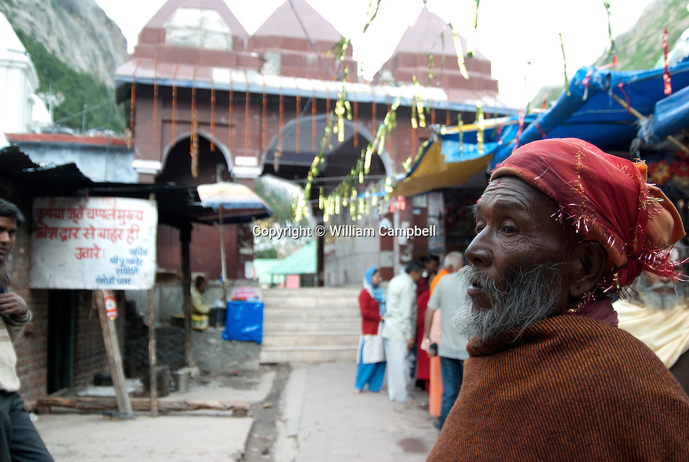 Religious pilgrims at the town of Gangotri on the Bhagirathi River that feeds the Ganges River. Thousands of Hindu religious pilgrims make the trek to Gangotri and the Gangotri Glacier each year to take a dip in the sacred waters that feeds the mother Ganges.