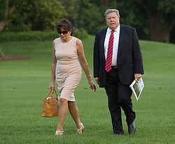Viktor and Amalija Knavs, the parents of U.S. First Lady Melania Trump arrive with U.S. President Donald Trump, Melania Trump and the Trumps, son Barron at the White House in Washington, DC, after a trip to New Jersey, June 11, 2017. Photo by Chris Kleponis