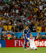 Germany's Philipp Lahm celebrates victory in front of Argentina's Martin Demichelis during the 2014 FIFA World Cup Final match at Maracana Stadium, Rio de Janeiro<br /> Picture by Andrew Tobin/Focus Images Ltd +44 7710 761829<br /> 13/07/2014