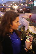"""Esther Bekerman prays and lights a candle outside the Kosher supermarket where a family member was wounded the day before<br /><br />French and Jews come together to make a vigil outside a Kosher supermarket in Porte Vincennes, Paris, France. Yesterday this Kosher supermarket was the scene of a hostage taking and followed by an armed shoot out between Jihadist gunmen and French police. It ended in a shoot out and with the death of the terrorists. Some hostages were killed and police injured.<br /><br />This event was directly linked to the attack on the offices of Charlie Hebdo, killing twelve people, including the editor and celebrated cartoonists two days before. This week was the deadliest week of terror attacks in France for over fifty years. Charlie Hebdo is a satirical publication well known for its political cartoons. <br /><br />As a solidarity actions with the deaths at Charlie Hebdo many placards read """"Je suis Charlie"""" translating as """"I am Charlie (Hebdo)"""". Demonstrators held aloft pens, brushes and crayons, symbolizing the profession of journalists and cartoonists who were killed."""